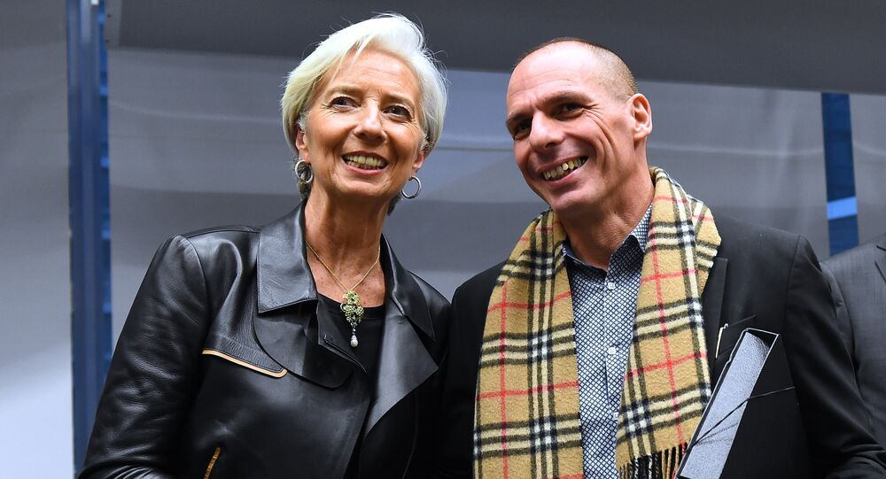 Greek Finance Minister Yanis Varoufakis (R) shakes hands with International Monetary Fund (IMF) Director Christine Lagarde