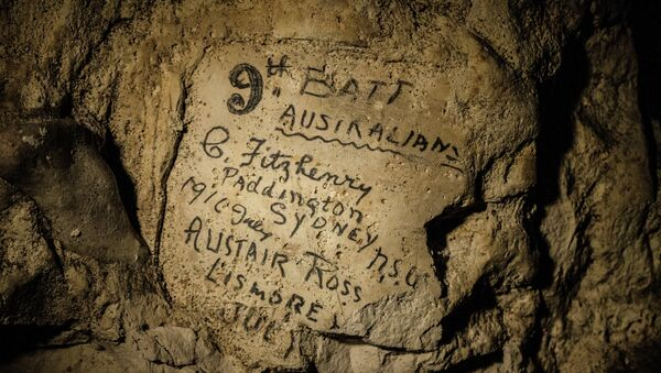 In this image made on Feb. 20, 2015 showing names engraved on the walls of a former chalk quarry, at the Cite Souterraine, Underground City, in Naours, northern France by 9th Batt Australians, G. Fitzhenry of Paddington, Sydney from 1916 July and Alistair Ross, Lismore, Australia - Sputnik International