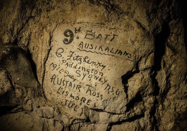 In this image made on Feb. 20, 2015 showing names engraved on the walls of a former chalk quarry, at the Cite Souterraine, Underground City, in Naours, northern France by 9th Batt Australians, G. Fitzhenry of Paddington, Sydney from 1916 July and Alistair Ross, Lismore, Australia