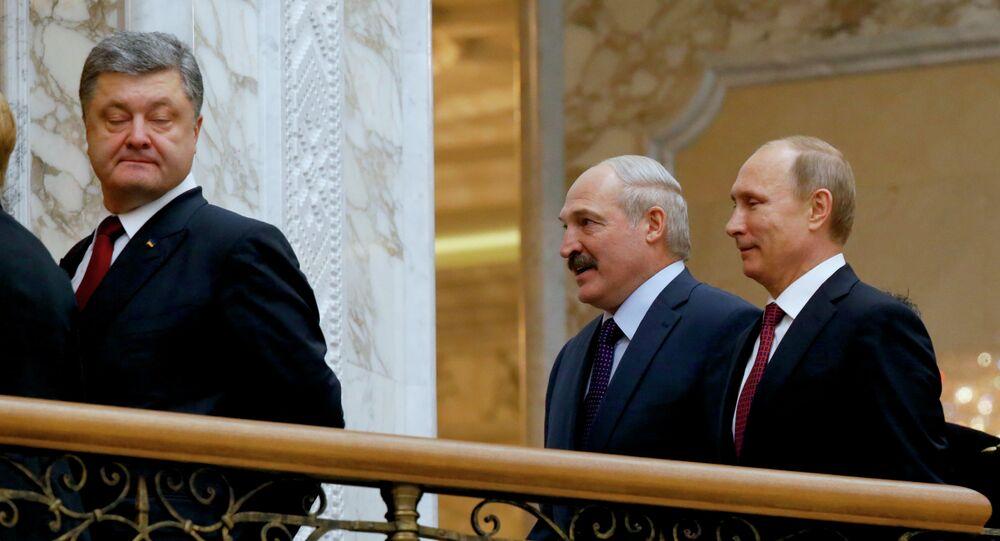Ukrainian President Petro Poroshenko, left, is followed by Russian President Vladimir Putin, right, and Belarusian President Alexander Lukashenko, heading for a broader meeting involving senior officials in Minsk, Belarus, Wednesday, Feb. 11, 2015