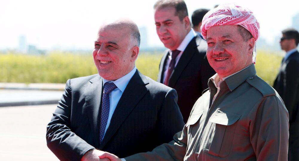 Iraqi Kurdish regional President Massoud Barzani (R) shakes hands with Iraqi Prime Minister Haider al-Abadi at Arbil International Airport April 6, 2015