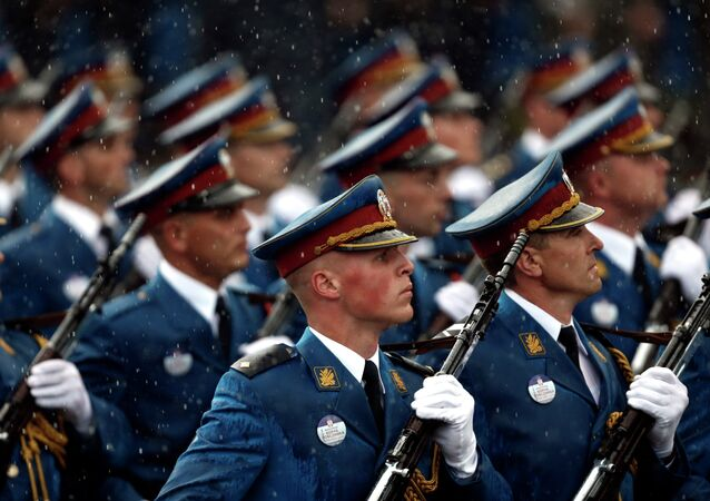 Serbian army Honor Guard members march during a military parade in Belgrade, Serbia, Thursday, Oct. 16, 2014