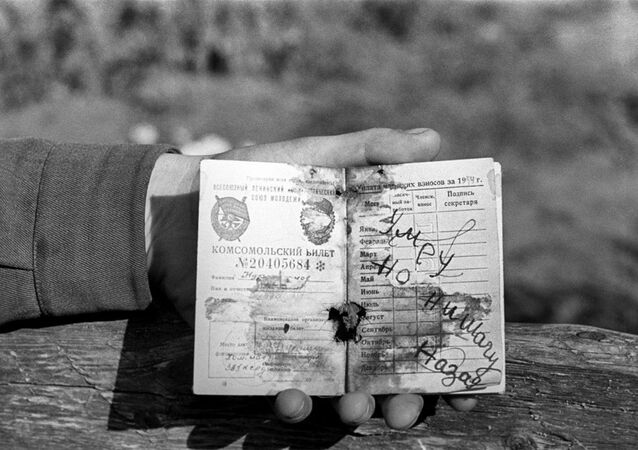 Komsomol ID of a Soviet WWII soldier, with words [I] will die but won't retreat scribbled on it.