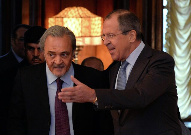 Russian Foreign Minister Sergey Lavrov (R) welcomes Saudi Foreign Minister Prince Saud al-Faisal on November 21, 2014 before their meeting in Moscow