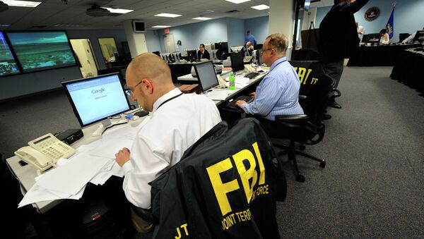 Agents from the FBI and other law enforcement agencies work at a 24-hour operations center at FBI headquarters, Monday, May 3, 2010, in the Chelsea section of New York - Sputnik International