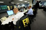 Agents from the FBI and other law enforcement agencies work at a 24-hour operations center at FBI headquarters, Monday, May 3, 2010, in the Chelsea section of New York