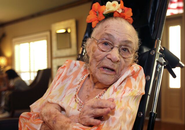 In this Thursday, July 3, 2014 photo, Gertrude Weaver poses at Silver Oaks Health and Rehabilitation Center in Camden, Ark., a day before her 116th birthday