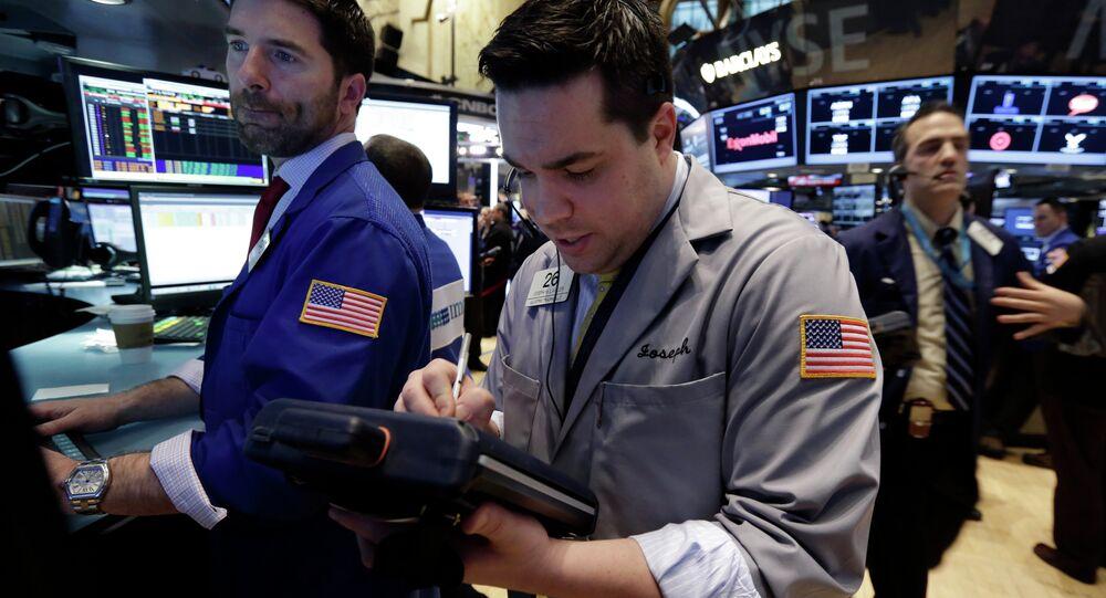 Trader Joseph Lawler, center, works on the floor of the New York Stock Exchange, Thursday, March 5, 2015