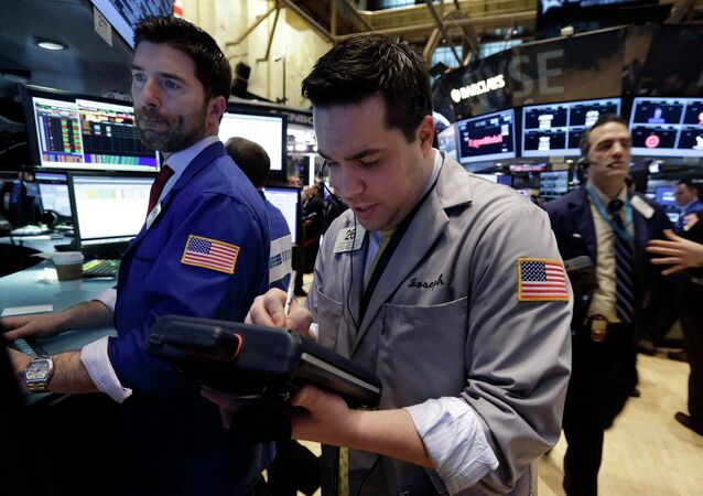 Trader Joseph Lawler, center, works on the floor of the New York Stock Exchange, Thursday, March 5, 2015