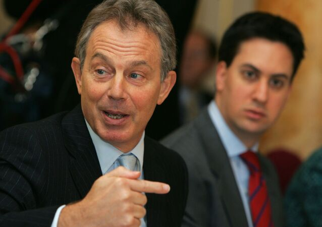 Former British Prime Minister Tony Blair and Labour leader Ed Miliband