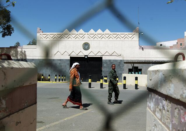 Yemeni men walk past the compound of the US embassy in Sanaa on March 4, 2015