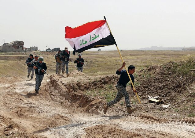 Member of the Iraqi security forces running to plant the national flag as they surround Tikrit during clashes to regain the city from Islamic State militants.