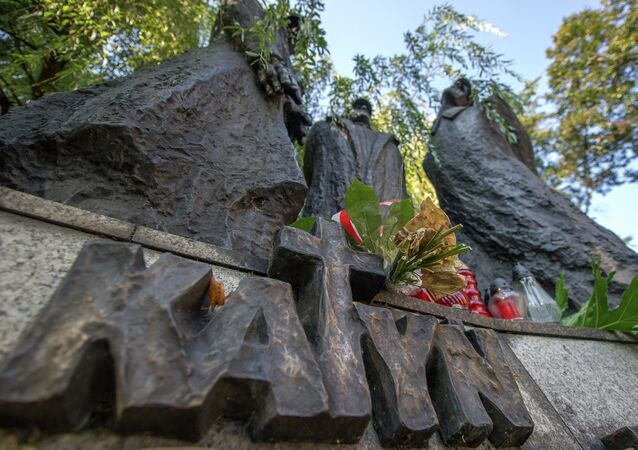 Flowers and candles rest on a memorial dedicated to the Katyn victims, to mark the 75th anniversary of the Soviet invasion of Poland at the start of WWII, in Katowice, Poland on September 17, 2014