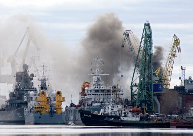 Smoke rises from a dock where the Orel nuclear submarine, a cruise missile type sub with two reactors that is classified as Oscar-II by NATO, is for repairs at the Zvyozdochka shipyard in the northern city of Severodvinsk on April 7, 2015