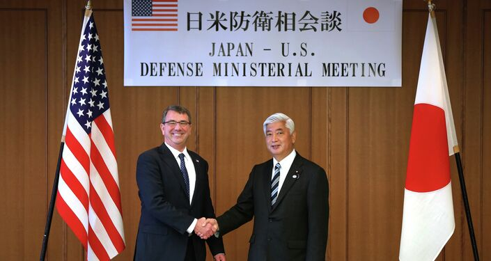 U.S. Defense Secretary Ash Carter, left, and Japan's Defense Minister Gen Nakatani shake hands prior to a meeting at the Defense Ministry in Tokyo.