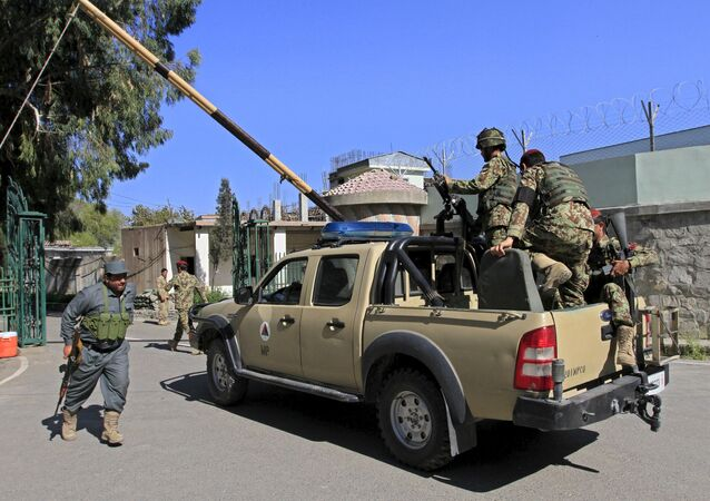 Afghan National Army soldiers (ANA) (R) arrive at the compound of a provincial governor's office in Jalalabad