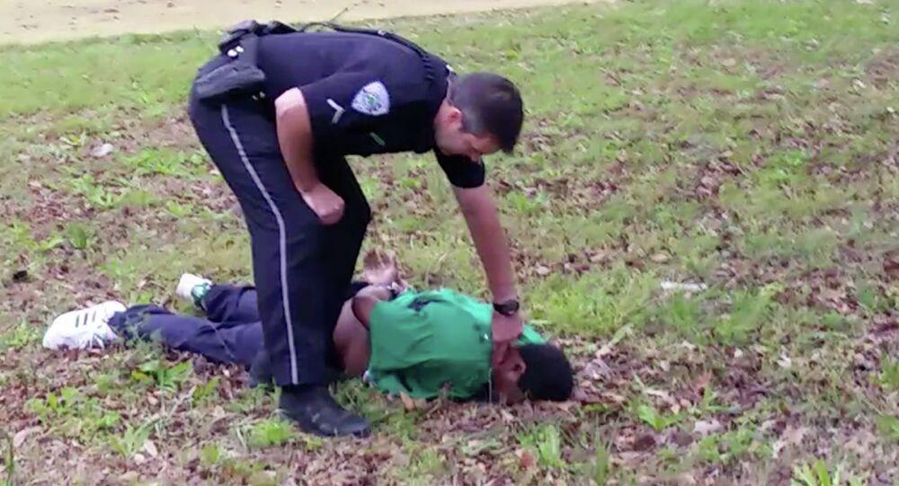 City patrolman Michael Thomas Slager checks Scott's pulse in North Charleston, S.C