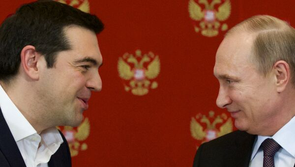 Russian President Vladimir Putin, right, and Greek Prime Minister Alexis Tsipras speak during a signing ceremony in the Kremlin - Sputnik International