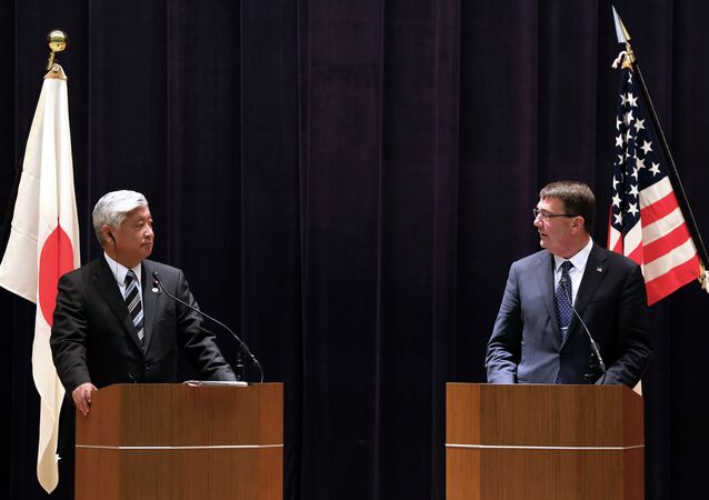 U.S. Defense Secretary Ash Carter, right, and Japan's Defense Minister Gen Nakatani speak during a press conference at the Defense Ministry in Tokyo