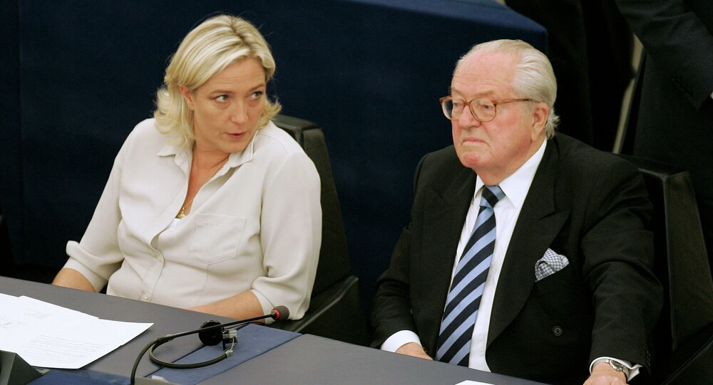 Jean-Marie Le Pen, right, and his daughter Marine Le Pen sit at the European Parliament, in Strasbourg, eastern France