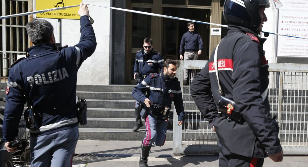 Policemen run out of the tribunal building in Milan, Italy