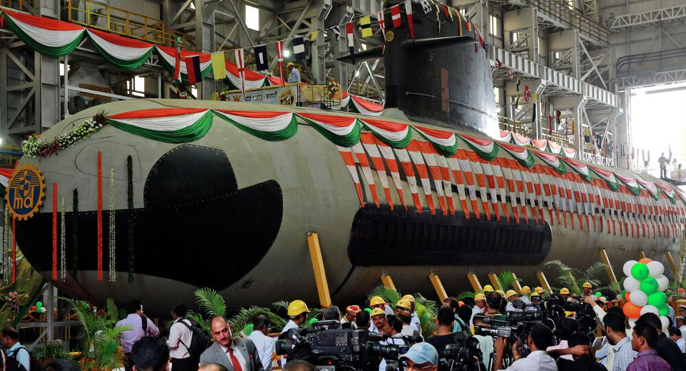 Employees and journalists gather around the Indian Navy's first indigenously-built Scorpene attack submarine at Mazagon Dock in Mumbai, India.