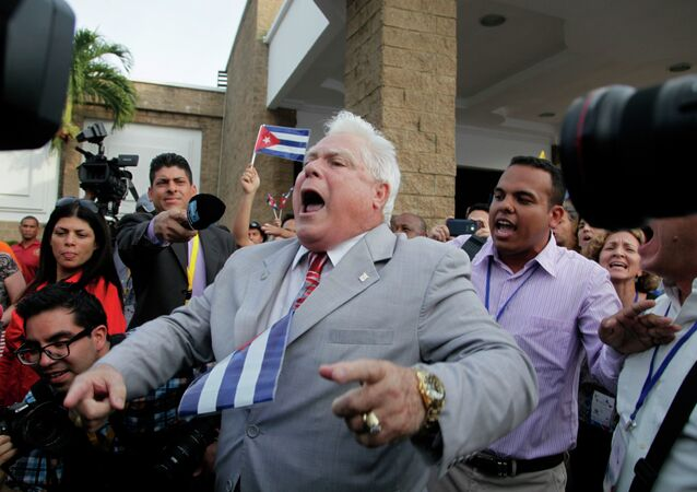 A man shouts slogans against pro-government supporters from Cuba and Venezuela outside the Vasco Nunes De Balboa Convention Center in Panama City