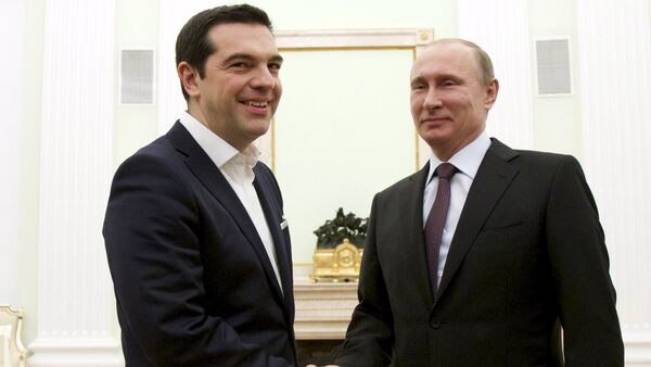 Russian President Vladimir Putin, right, shakes hands with visiting Greek Prime Minister Alexis Tsipras in Moscow's Kremlin, Russia - Sputnik International