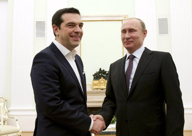 Russian President Vladimir Putin, right, shakes hands with visiting Greek Prime Minister Alexis Tsipras in Moscow's Kremlin, Russia