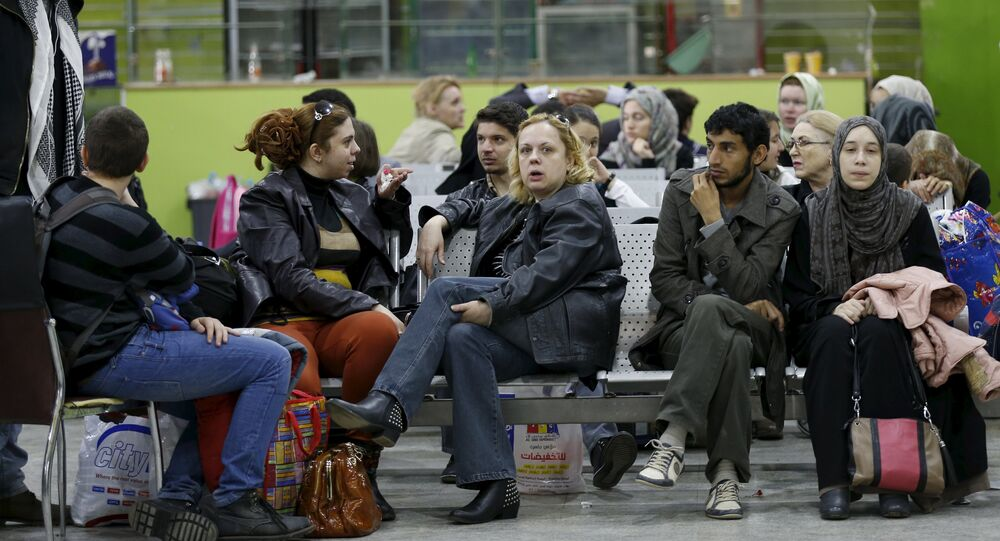 People wait in the departure lounge at Sanaa International Airport, where foreigners are being evacuated from Yemen