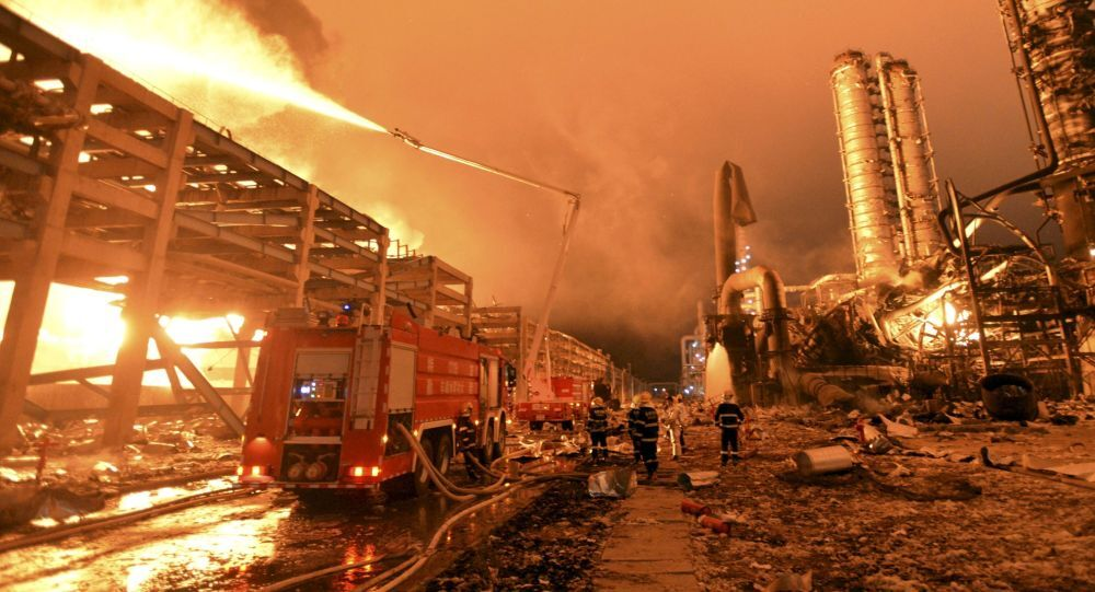 Firefighters try to extinguish a fire at a petrochemical plant in Zhangzhou, Fujian province April 7, 2015. At least six people were injured after an explosion hit part of an oil storage facility on Monday at Dragon Aromatics, an independent petrochemical producer in eastern China, Xinhua reported.