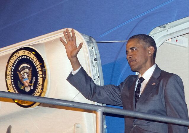 U.S. President Barack Obama waves during his arrival on Air Force One Thursday, April 9, 2015, at Tocumen International Airport in Panama City, Panama.