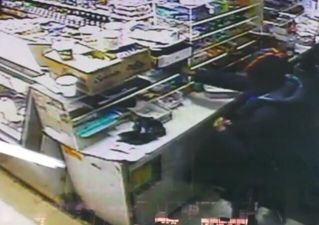 NYPD Detective Caught on Tape Taking Money from Deli