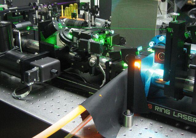A Rhodamine laser dye (fluorescing orange) pumped with several Watts of Argon-ion laser radiation (bright blue)