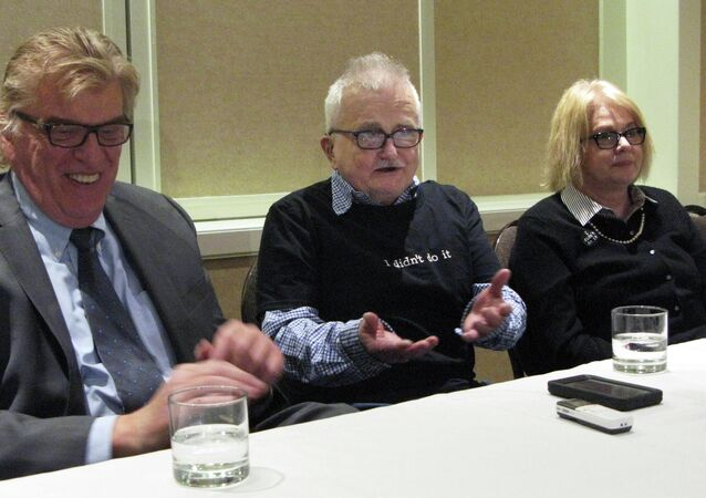 Richard Lapointe, center, who was freed on bond after 25 years in prison, speaks to members of the media between attorney Paul Casterleiro, left, and Kate Germond, right, co-director of Centurion Ministries, Friday, April 10, 2015, in Hartford, Conn.