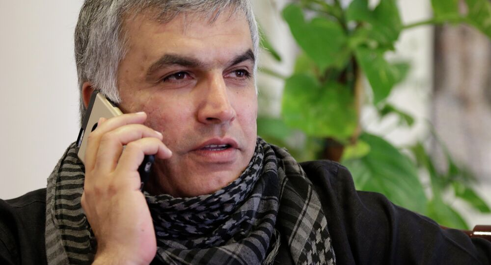 Nabeel Rajab, one of Bahrain's best-known human rights activists, gets word from his lawyer on his appeal at his home in Bani Jamra, Bahrain, Sunday, March 15, 2015.