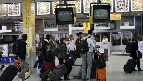 People wait in the departure lounge at Sanaa International Airport - Sputnik International