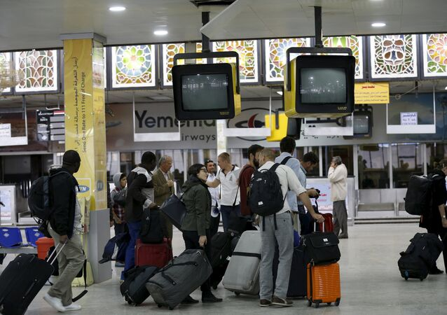People wait in the departure lounge at Sanaa International Airport