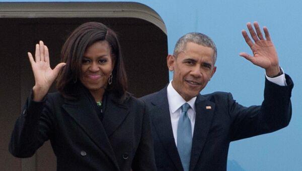 US President Barack Obama (R) and First Lady Michelle Obama (L) - Sputnik International