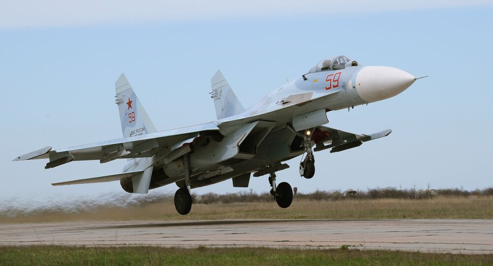 A Russian Su-27 jet fighter flew dangerously close to and nearly collided with a US reconnaissance plane over the Baltic Sea