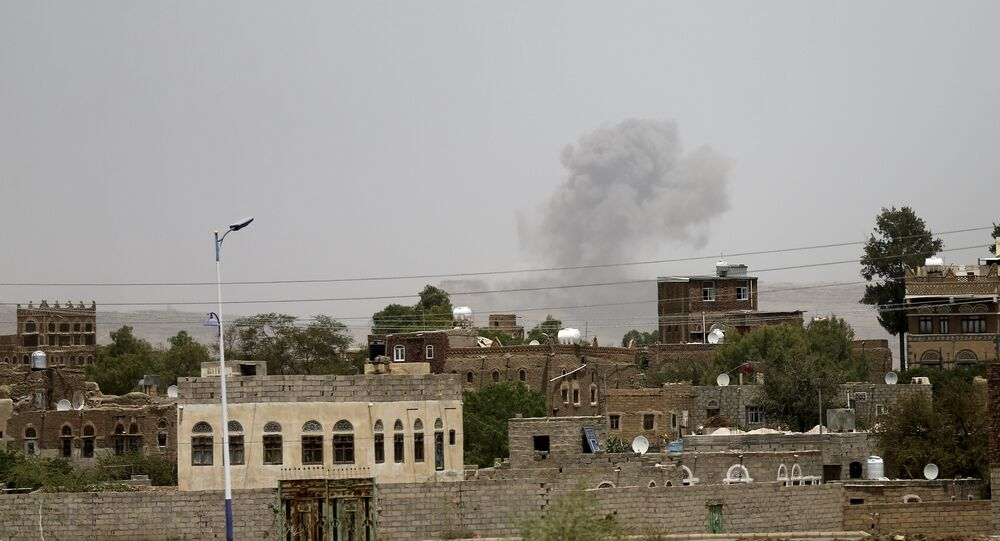 Smoke rises from a military post after it was hit by an air strike in Sanaa April 11, 2015.
