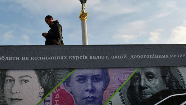 A man stands next to an advertising placard showing British pounds, US dollars and Ukrainian hryvnia banknotes in the Ukrainian capital Kiev - Sputnik International