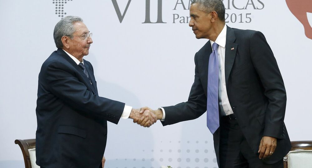 U.S. President Barack Obama shakes hands with Cuba's President Raul Castro as they hold a bilateral meeting during the Summit of the Americas in Panama City