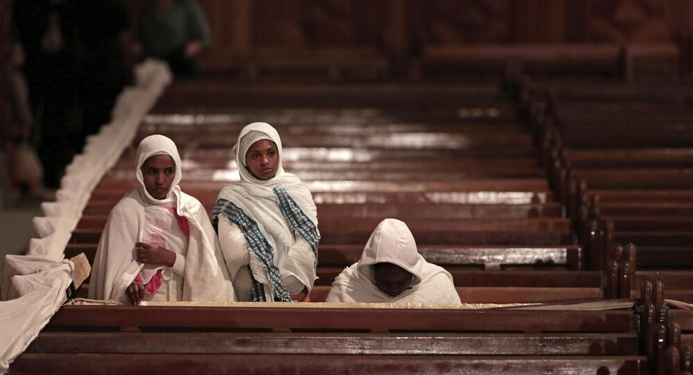 Ethiopian Christian women pray during the Easter Eve service at St. Mark's Cathedral, in Cairo, Egypt