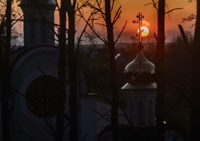 The Sun sets behind the St. Yelisei's Lavrishevo monetary during Orthodox Easter at the village of Gnesichi in the Grodno region, about 150 km from Minsk