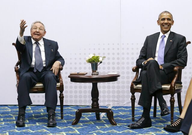 Cuba's President Raul Castro gestures to journalists that he is not taking questions as he and US President Barack Obama hold a bilateral meeting during the Summit of the Americas in Panama City, Panama