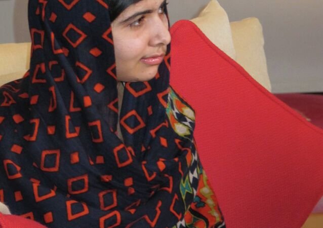 In this Jan. 22 2013 photo released Monday Feb. 4 2013, fifteen-year-old Malala Yousefzai relaxes