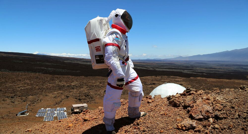 In this June 4 2013 photo provided by the University of Hawaii, research space scientist Oleg Abramov walks outside simulated Martian base at Mauna Loa, Hawaii