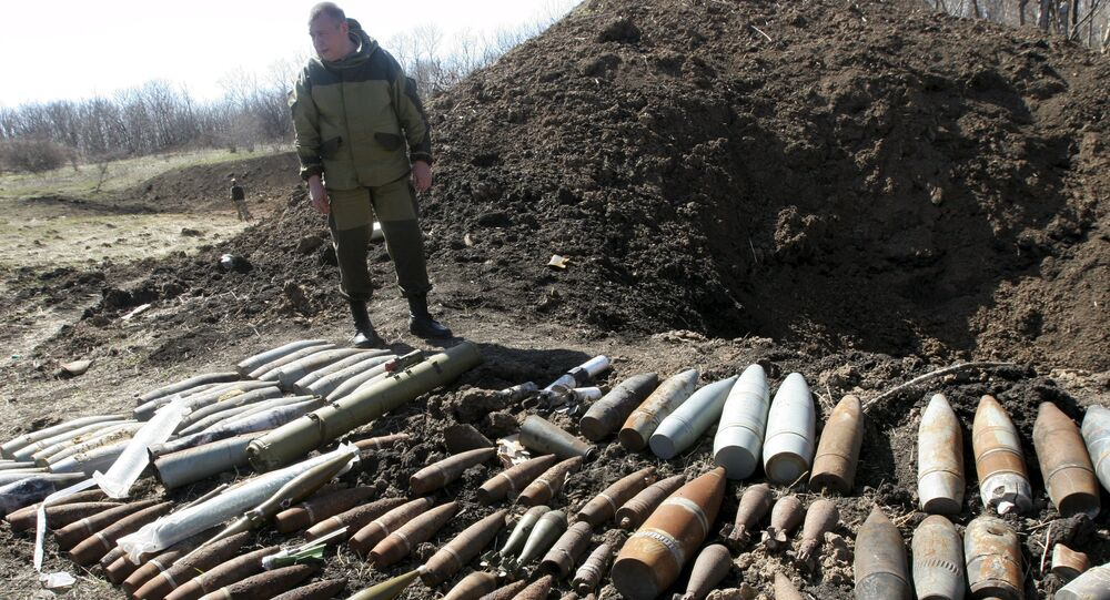 Independence supporter stands near Ukrainian military unexploded shells at a range in the suburbs of Donetsk April 10, 2015