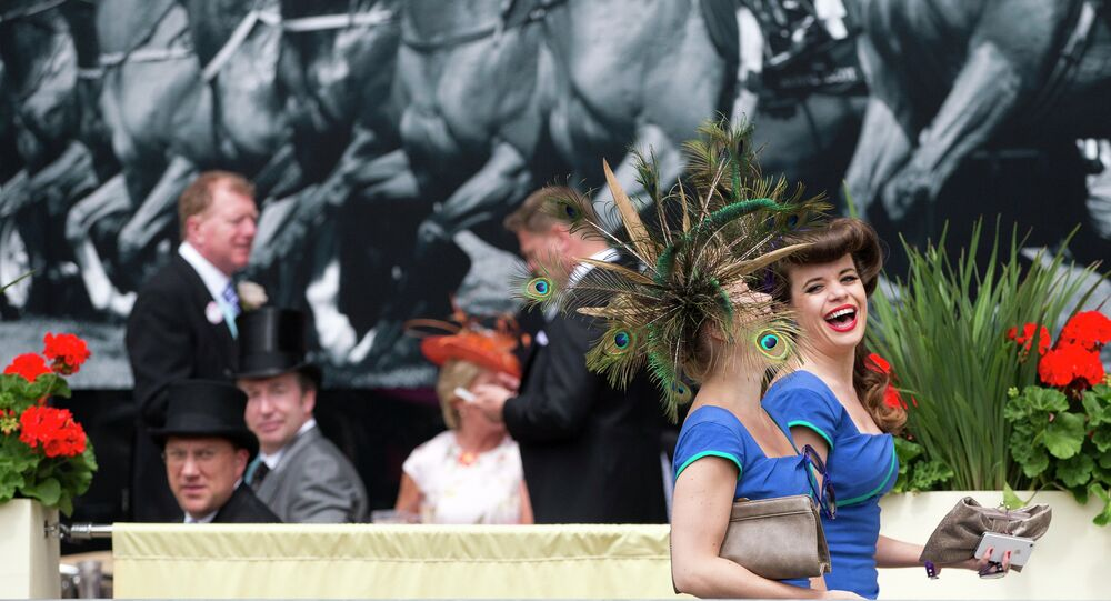 Two members of a choral group laugh as they walk near the parade ring on the third day of the Royal Ascot horse racing meeting, which is traditionally known as Ladies Day, at Ascot, England, Thursday, June, 19, 2014
